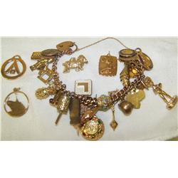 A 9K Yellow Gold Charm Bracelet  w/ 14K yellow gold (18.2 g)Charms & More  Bracelet weighs 81.3 G