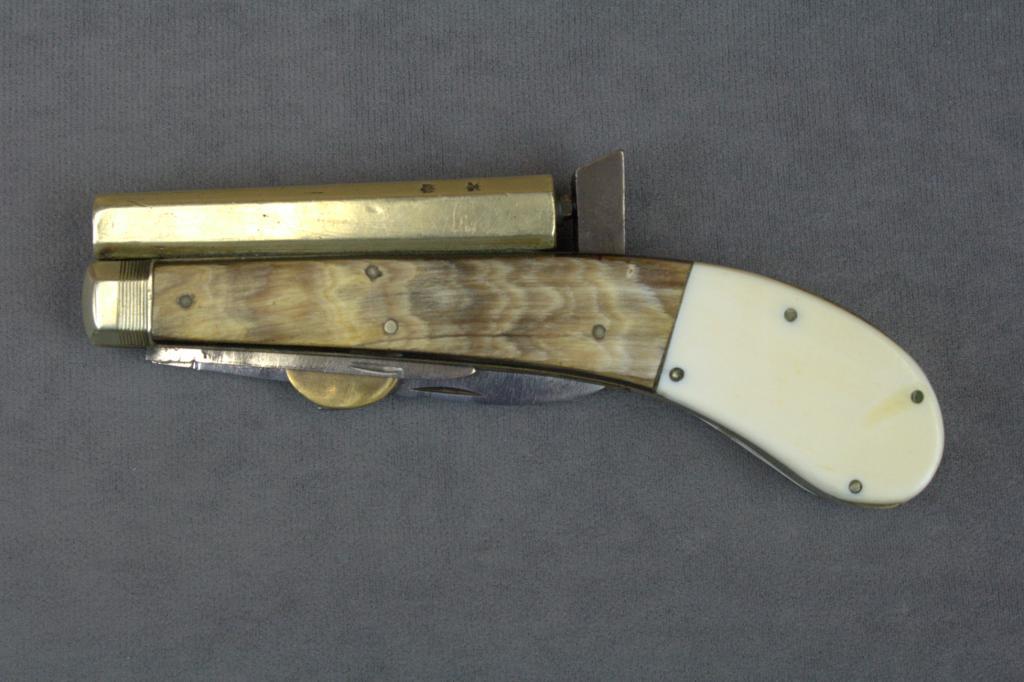 "Antique Knife pistol,  22 cal , 3-1/2"" barrel, two folding"