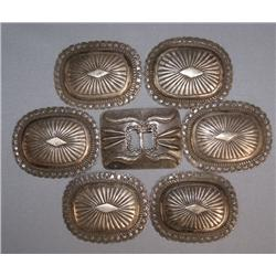 NAVAJO CONCHOS AND BUCKLE