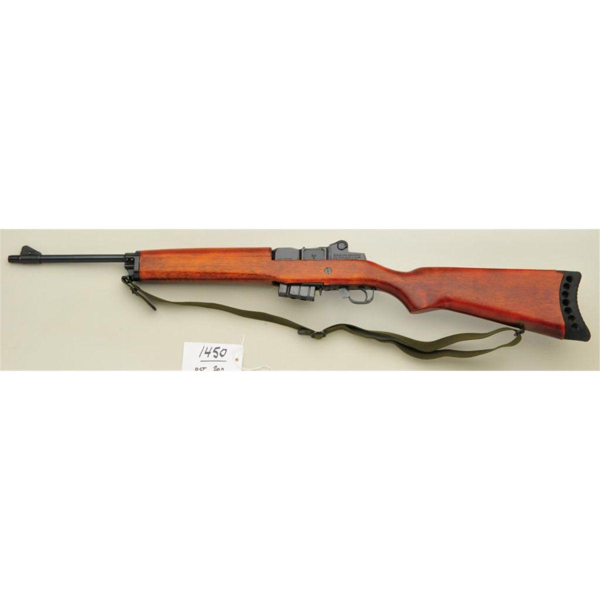 "Ruger Mini-14 semi-auto rifle,  223 cal , 18"" barrel, blue finish, wood  stock with olive green sli"
