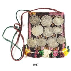 Bolivian alpaca-cloth coca leaf pouch with 10 silver coins sewn onto the outside.