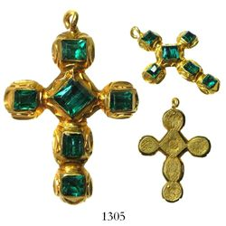 Gold cross studded with 6 high-grade emeralds, intricately engraved on back.