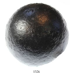"Intact ""12-pound"" iron cannonball."