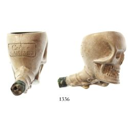 "French clay pipe with skull motif, marked ""Crème GRAMBIER,"" intact."