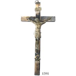 Large crucifix consisting of a wooden cross with metal Christ figure above skull-and-crossbones, fou