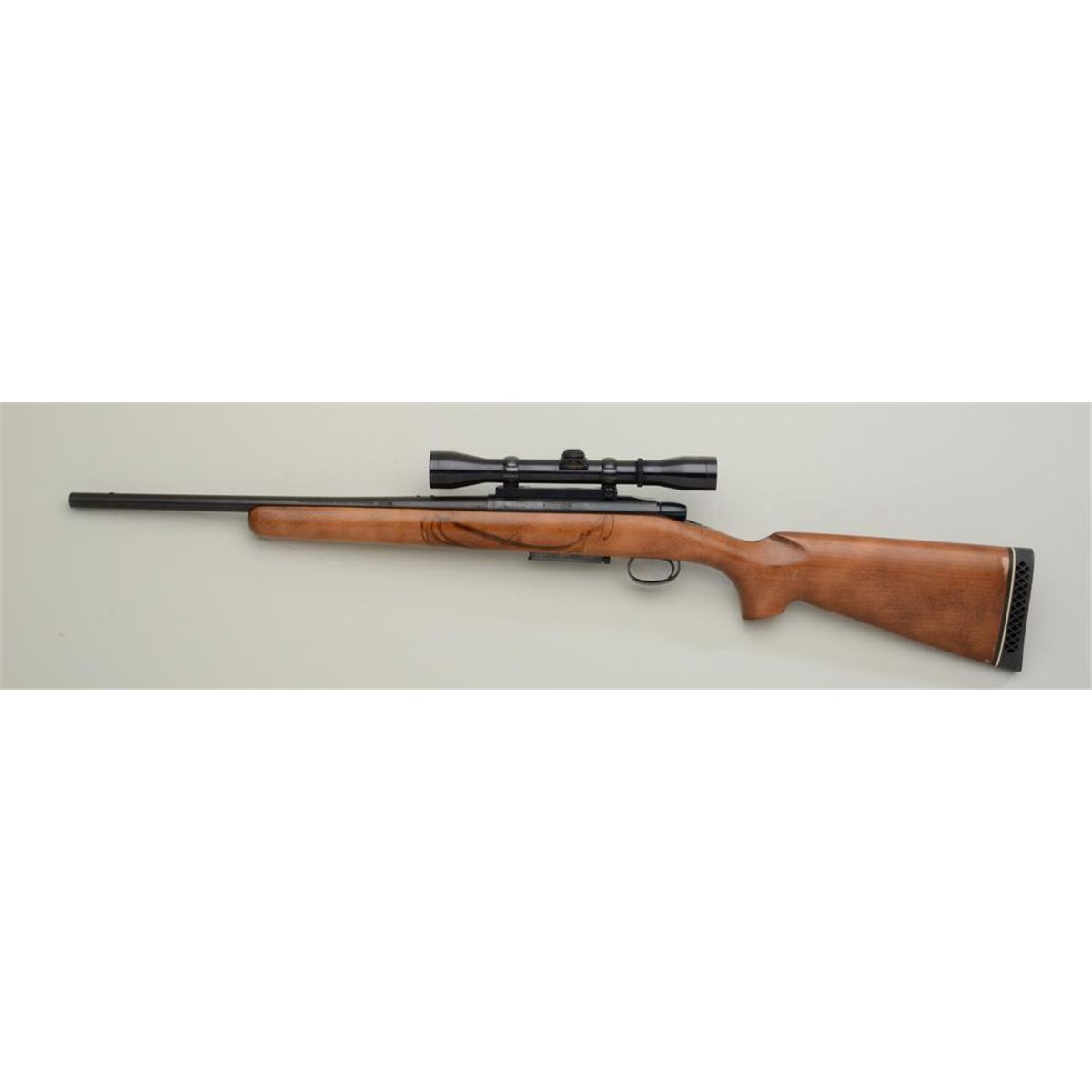 "Remington Model 788 bolt-action rifle,  308 Win  cal , 19"" round barrel,  blue finish, wood stock,"
