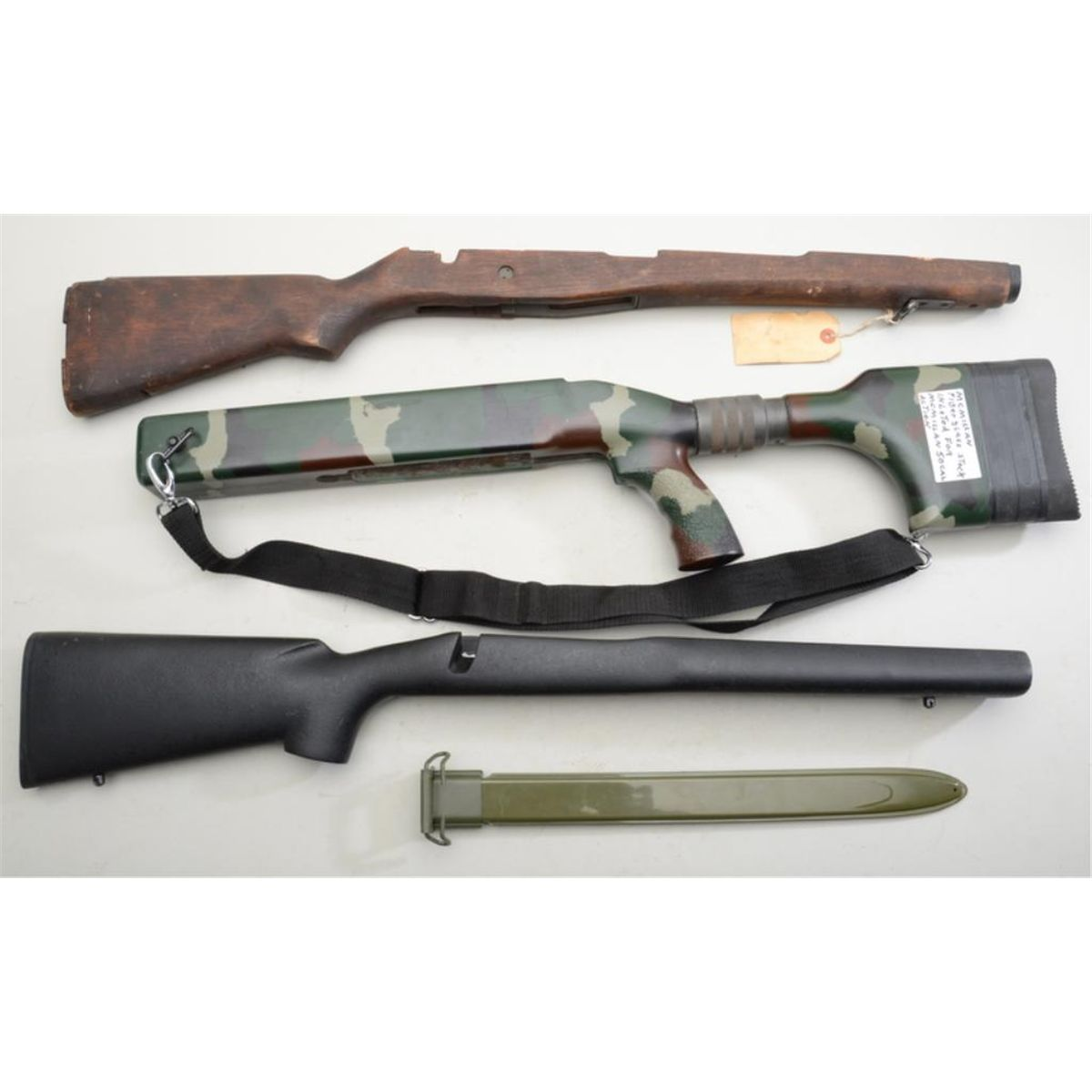 Lot of three rifle stocks and a reproduction U S  '03 bayonet