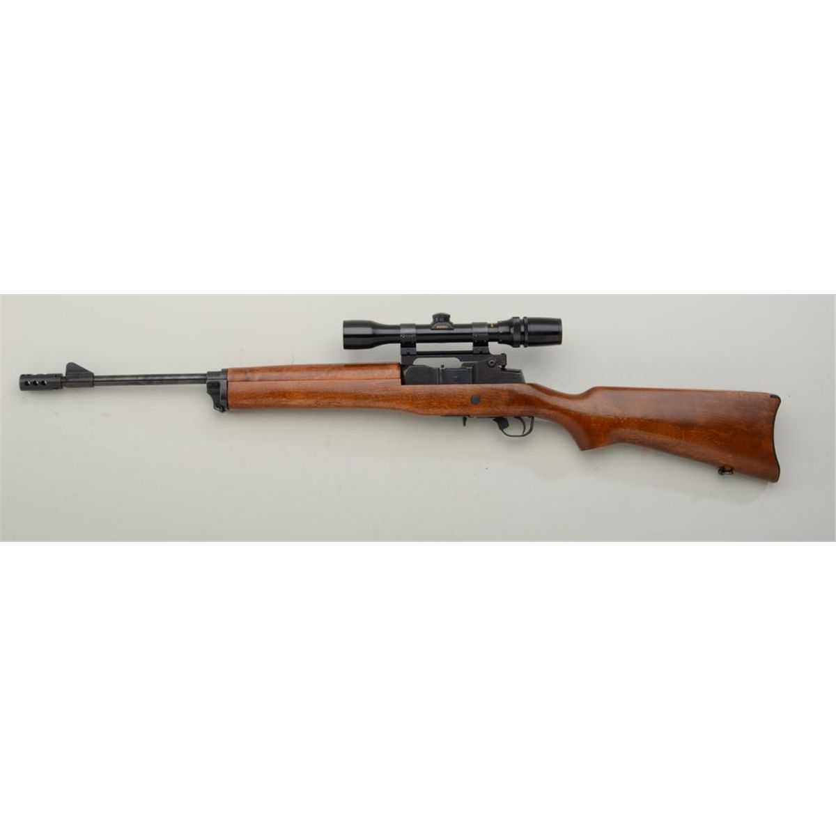 """Ruger Mini-14 semi-auto rifle,  223 cal , 19"""" barrel, black finish, wood  stock, mounted with a Bus"""