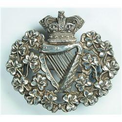 circa 1890: Royal Irish Regiment officer's pith helmet badge