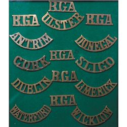 circa 1900: Irish militia Royal Garrison Artillery shoulder titles collection