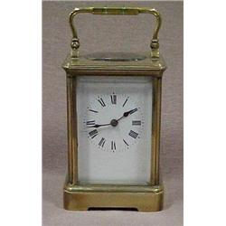 French carriage clock with brass and bevele
