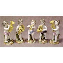 A set of five porcelain cherub figurines