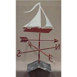 Painted iron weathervane with sailboat, ear