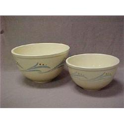 Two Roseville decorated utility ware mixing
