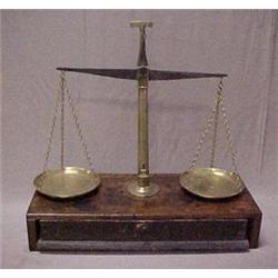 Brass balance scale on poplar base with one