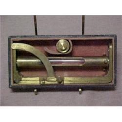 A brass surveyor's measuring tool with level
