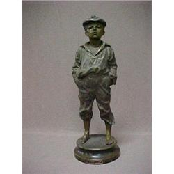 A spelter figurine of a boy  Le Siffleur