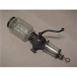 Iron coffee grinder marked Crystal