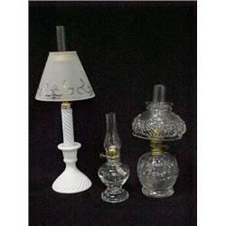 Three oil lamps including milk glass peg