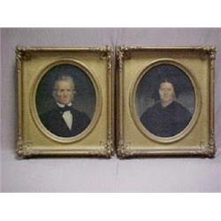 A pair of gilt framed oval portraits of a