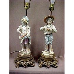 A pair of porcelain figural lamps of a girl