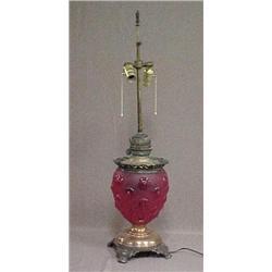 Bull's eye red glass oil lamp on metal base
