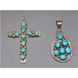 2 Navajo silver pendants