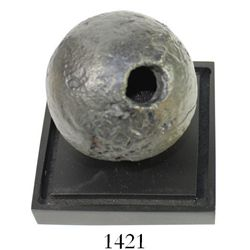 """Iron cannonball grenade, professionally conserved, in plastic display case.  1141 grams, 3"""" in diame"""