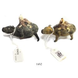 """Pair of earthenware """"boy-on-buffalo"""" figurines, probably game-pieces, some legs missing.  24.4 and 2"""