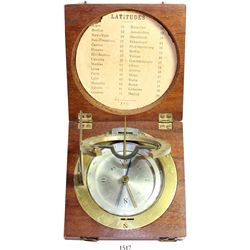 Equinoctial sundial (compass) in mahogany box, 1800s, with original paper latitude chart inside lid.