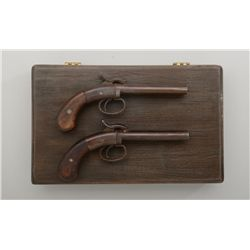 """Modern cased pair of reproduction double  barrel percussion derringers by Hoppe's, .36  cal.,4"""" barr"""