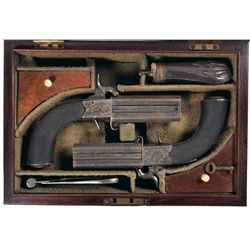 Cased Engraved Pair of English Wilson Over/Under Swivel Breech Percussion Large Caliber Pistols