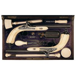 Magnificent Cased Pair of 19th Century, Ivory Stocked, Engraved, Gold-Inlaid Target Pistols Marked D