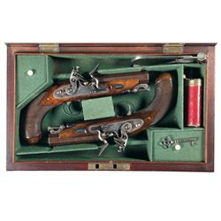 Spectacular Cased Engraved Silver Inlaid Matching Pair of William Moore Flintlock Pistols