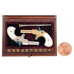 Cased Engraved Sequential Pair of L.H. Smith Miniature Remington-Elliot Derringers