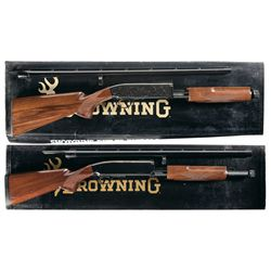 Two Boxed Browning Slide Action Shotguns