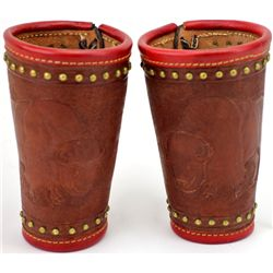 Large pair contemporary cowboy cuffs with tooled buffalo, spots, opening trimmed in contrasting red
