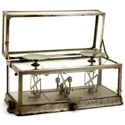 Antique beam scale in original nickel and glass case with hinged top lid, by The Portion Balance Co.