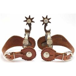 Pair Walt Rambo bottle opener spurs double mounted and marked on inner heal band. Includes unmarked
