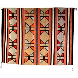 "C. 1940-1950's Navajo rug with banded and geometric patterns, 53"" X 67"". Good rug showing fine condi"
