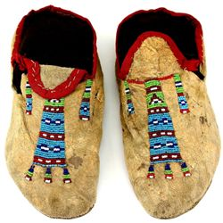 C. 1890's Northern Plains moccasins with beaded geometric pattern tops, openings red trim cloth, ori