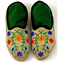 C. 1900 Santee Sioux beaded moccasins with black cloth lined openings, fitted with original hard sol