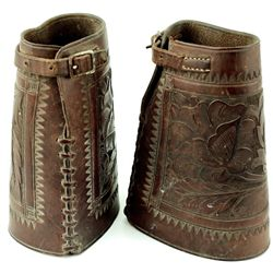 Pair early cowboy cuffs floral carved unmarked showing very good conditions, buckles and straps inta
