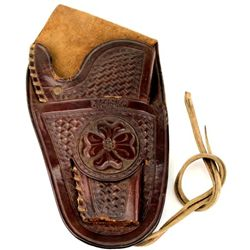 "RT Frazier stamped brown leather holster fits Colt SA 4 3/4"" revolver, floral carved and basket stam"
