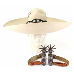 Matching sombrero and spurs the felt sombrero embroidered with initials O.F., satin liner and sweat