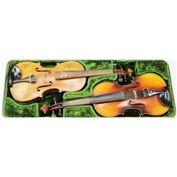 "Double cased violin set in fitted leather case the first violin with paper tag ""copy of Antonius Str"