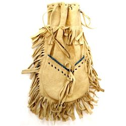 Early 20th C. beaded Ojibwa draw string bag with incorporated pouch on the back, floral beaded to fr