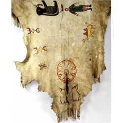 Painted buffalo hide with horsehair drops. Shows several small hole repairs but overall very good, p