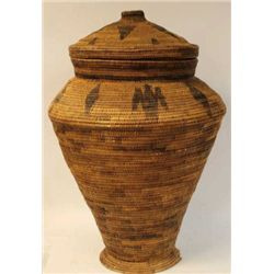 "Very large coiled and footed basket showing bird and diamond effigy's with lid, 36"" tall."
