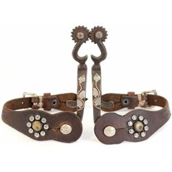Pair unmarked McChesney spurs single mounted with Weldon stamped leather straps.